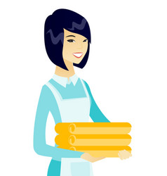 Young asian housekeeping maid with stack of linen vector