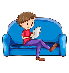 A boy sitting at the sofa with a gadget vector