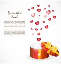 Gift box with gold ribbons vector image