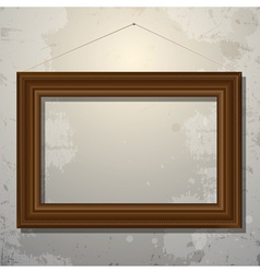 Wooden empty frame of picture on old wall vector image