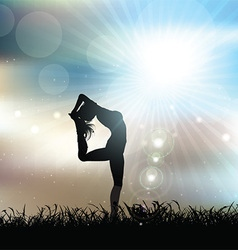 Silhouette of a female in a yoga pose in sunny vector image vector image