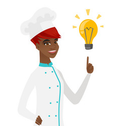 Young african-american chef pointing at lightbulb vector