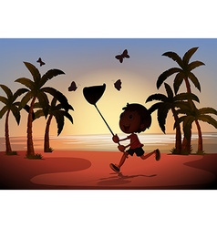 Silhouette boy catching butterflies vector
