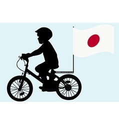 A kid rides a bicycle with Japan flag vector image