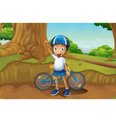 A young biker in the forest vector