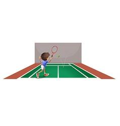 A boy playing tennis at the court vector