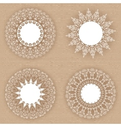 Set of lacy white frames on cardboard background vector