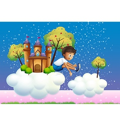 A boy jumping near the castle vector