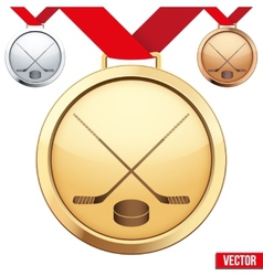 Gold medal with the symbol of ice hockey inside vector
