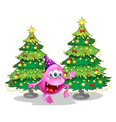 A pink beanie monster near the green christmas vector image vector image