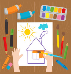 Child draws at the desk vector