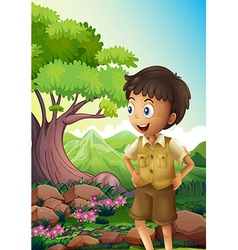 A young boyscout in the forest vector