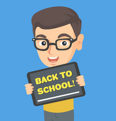 Schoolboy holding tablet with text back to school vector