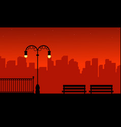 Silhouette of urban and street lamp on red vector