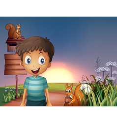 A young boy and two squirrels near the empty vector image