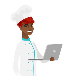 Young african-american chef using a laptop vector