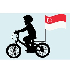 A kid rides a bicycle with Singapore flag vector image vector image