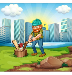 A man chopping woods across the tall buildings vector