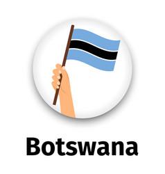 botswana flag in hand round icon vector image vector image
