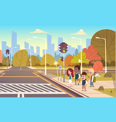 group of school children waiting for green traffic vector image vector image