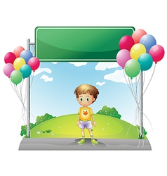 A young boy standing below the empty signage in vector