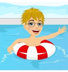 Little boy swimming in pool with inflatable ring vector