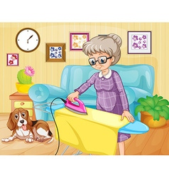 Old woman ironing clothes in a room vector image