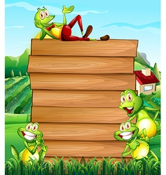 Wooden board and frogs in the field vector image
