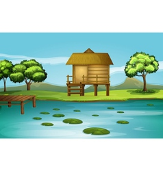 A hut at the riverbank vector