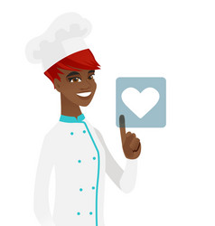 Young african chef pressing web button with heart vector