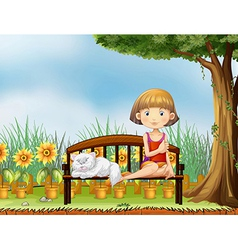 A girl with a cat in the garden vector image