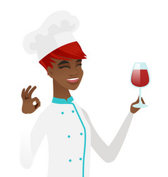 Chef holding glass of wine and showing ok sign vector