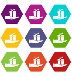 gift box in hand icon set color hexahedron vector image