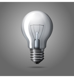 Realistic light bulb isolated on grey background vector