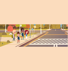 Group of school children waiting for green traffic vector