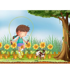 A girl playing jumping rope with a dog vector image vector image