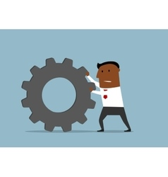 Unhappy businessman pushing a gear wheel vector image