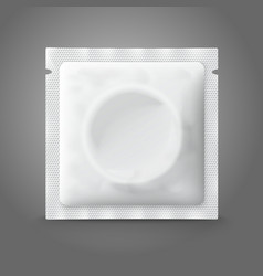 Blank white plastic condom pack isolated on grey vector