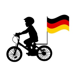 A kid rides a bicycle with german flag vector