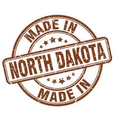 Made in north dakota brown grunge round stamp vector