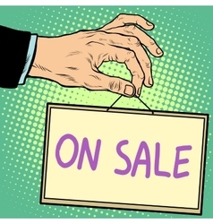 Hand holding a sign on sale vector image vector image