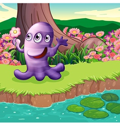 A three-eyed violet monster at the riverbank vector