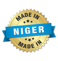 Made in niger gold badge with blue ribbon vector