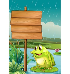 A frog near an empty wooden board vector image