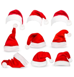 Collection of red santa hats vector