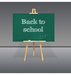 Green school board with chalk on a tripod vector image vector image