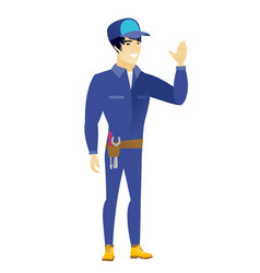 young asian mechanic waving his hand vector image vector image