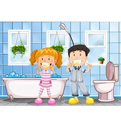 Boy and girl brushing teeth in the bathroom vector image