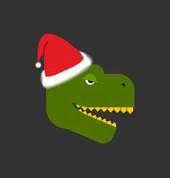 Dino santa tyrannosaurus and claus cap red hat vector