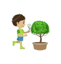 Boy shaping the bush vector